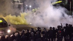 Police use tear gas, pepper spray on protesters outside Trump rally