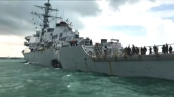 Navy destroyer collides with merchant ship; at least 10 missing