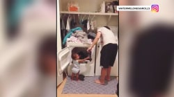 Watch this adorable 1-year-old help her daddy do laundry
