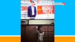 Watch Michael Phelps' son Boomer wave to him  on TV