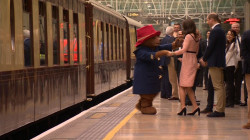 Duchess Kate dances with Paddington Bear during surprise appearance
