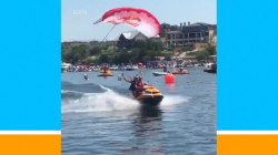 Parachuter lands on back of moving jet ski, caught on video