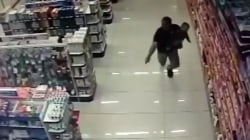 Caught on video: Cop shoots robbery suspects while holding baby