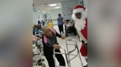Watch this 90-year-old woman break it down with Santa