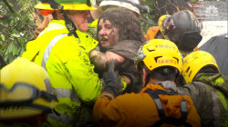 Firefighters rescue girl trapped in mudslide rubble