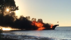 Boat catches fire off Florida, forcing dozens into chilly waters; 1 dead