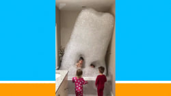 Dad and his kids build awesome bubble tower in bathtub