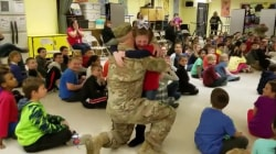 Watch returning military dad surprise his 7-year-old daughter at school