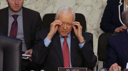 Sen. Orrin Hatch reaches for eyeglasses that aren't there