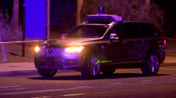 Uber halts self-driving testing after fatal pedestrian crash