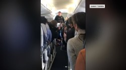 Woman attempts to open airplane door in mid-flight