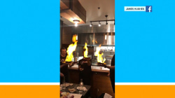 Flaming food triggers sprinklers, leaving these diners all wet