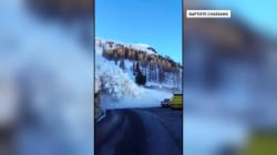 Avalanche sends workers running, caught on camera