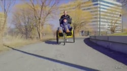 Woman pushes paralyzed boyfriend along Boston Marathon route