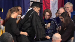 Georgetown football player paralyzed in 2015 walks at his graduation