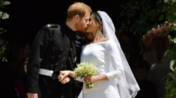 See Prince Harry and Meghan's kiss on the chapel steps