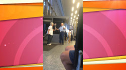 Watch loving husband greet his wife at airport with flowers and chocolates