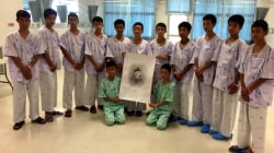 Rescued boys in Thailand hold moment of silence for Navy diver who died