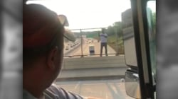 Truck driver talks man off ledge by offering beer