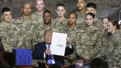 Trump signs military spending bill named after McCain, but doesn't mention him