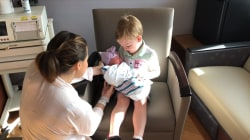 Older brother welcomes new baby sister in the most adorable way