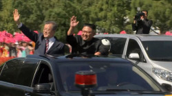 Kim Jong Un, Moon Jae-in embrace at start of Korean summit