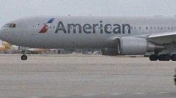 12 passengers quarantined on 2 American Airlines flights