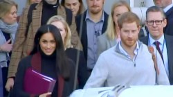 Beaming Meghan and Harry arrive in Australia as news of pregnancy breaks