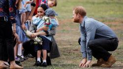 Meghan, Duchess of Sussex, hugs a young fan in Australia