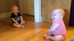 Watch: Baby twins can't stop making each other laugh