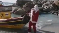 Watch: Clumsy Santa Claus falls over boat when delivering gifts