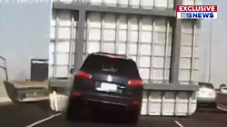Frightening video shows sign falling onto freeway, crushing car