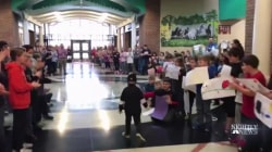 Kindergartner battling cancer gets a hero's welcome from his classmates