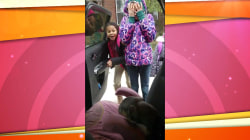 Dad surprises daughters with puppy at their school