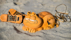 Here's why novelty Garfield phones are washing up on France beaches