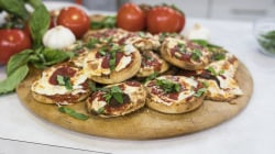 Lucali owner Mark Iacono makes English muffin pizzas