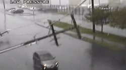 Frightening video shows power poles crashing down onto car