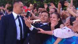Ukraine's comedian-turned-president takes selfies, high-fives at inauguration