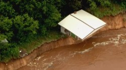 Dangerous flooding in South prompts emergency rescues