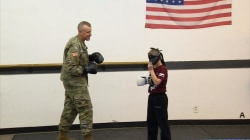 9-year-old recounts viral surprise by military father