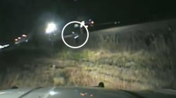Cop saves driver stuck on train tracks with seconds to spare