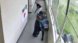 Video shows coach disarming and then hugging student at high school