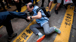 Hong Kong protesters beat man who confronts them for occupying streets