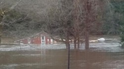 Striking video shows home floating down a river after heavy flooding hits area
