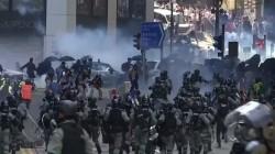 Hong Kong protester shot and critically wounded as violence escalates