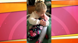 See this proud 3-year-old cuddle her newborn baby sister
