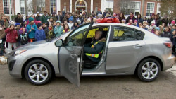 Neighbors surprise beloved crossing guard with a new car
