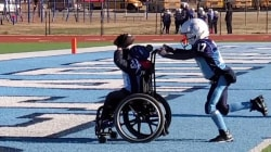 Boy with spina bifida scores touchdown in wheelchair