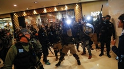 Police and protesters clash in Hong Kong's shopping malls