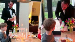 Dad dons waiter's tuxedo to serve his kids a fancy dinner at home